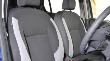 A height adjustable seat and steering wheel are optional unless you get the top Laureate trim