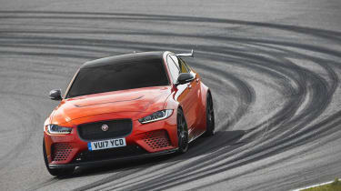 Strong, weight-saving carbon-fibre has been used for the bonnet, front and rear bumpers...