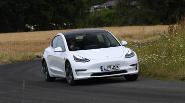 Tesla Model 3 - front 3/4 view dynamic cornering