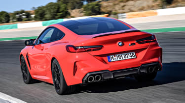 BMW M8 Competition coupe rear 3/4 tracking on track