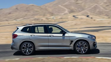 BMW X3 M Competition SUV side panning on track