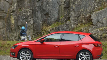 Side view of red SEAT Leon
