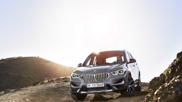 2019 BMW X1 SUV - front 3/4 wide off-road