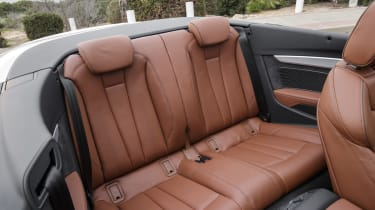 The Audi A5 Cabriolet is a '2+2', meaning there's no middle seat in the rear bench for a fifth passenger.