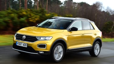 Volkswagen T-Roc SUV front 3/4 tracking yellow