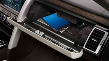 There's a 12V socket for charging devices in the glove box too