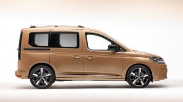 Volkswagen Caddy in brown - side