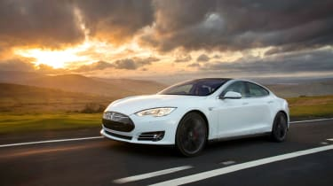18% of readers said taking a Tesla Model S - complete with glass roof - to see the Northern Lights would make a perfect trip