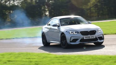 BMW M2 Competition cornering with tyre smoke