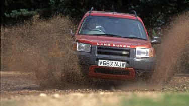 MK1 Land Rover Freelander driving through muddy river