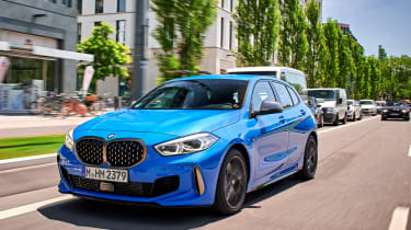 BMW M135i driving in a city