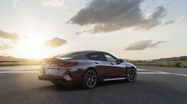 BMW M8 Gran Coupe parked on a runway