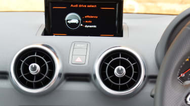 A multimedia infotainment screen lowers into the dash when not needed