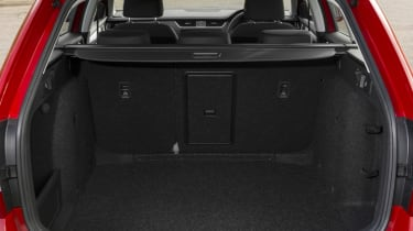 A hatch in the rear seatback allows long items to intrude into the passenger compartment