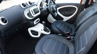 The Passion model offers buyers a choice between black and grey seats (seen here) and black and orange.