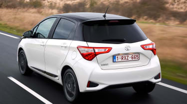 Toyota Yaris driving away from camera