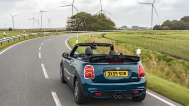 MINI Sidewalk Convertible driving on road near wind turbines