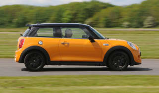 Yellow MINI driving - side view