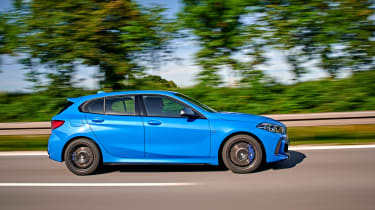 BMW M135i driving - side view