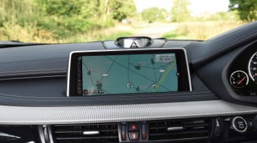 The infotainment system is easy to use thanks to BMW's iDrive controller, and features internet services