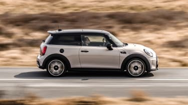 2021 MINI hatchback driving - side view