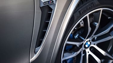 Enhanced brakes sit behind huge 20-inch alloy wheels, providing ample stopping power