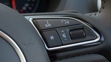 Steering wheel-mounted controls are included as standard