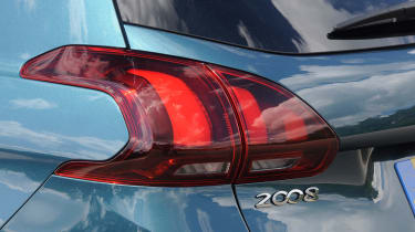 The rear lights are similar in style to the 308 hatchback