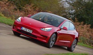 Tesla Model 3 saloon fron 3/4 cornering