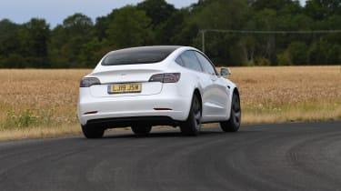 Tesla Model 3 - rear 3/4 view dynamic cornering