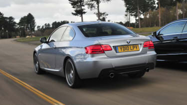 BMW 3 Series Coupe -  rear 3/4 driving