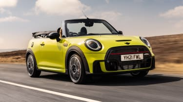 2021 MINI Convertible driving with roof down