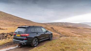 BMW X7 SUV muddy track