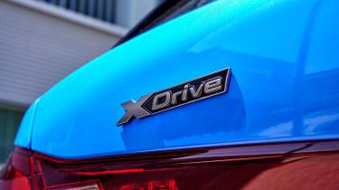 BMW M135i xDrive badge