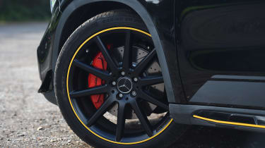 This even extends to the rims of the huge 20-inch black alloy wheels