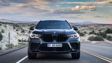 BMW X6 M Competition driving - front end view
