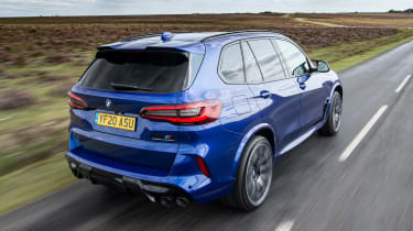 BMW X5 M Competition SUV rear 3/4 tracking