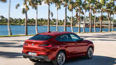 BMW X4 tracking shot, rear right