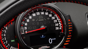 The speedometer, rev counter and fuel gauge sit in a pod in front of the steering wheel