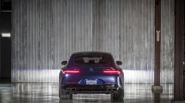 Mercedes-AMG GT 63 rear view, distant, lights on