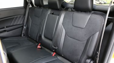 The centre seat has a fold-down armrest