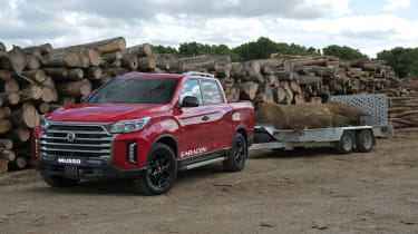 SsangYong Musso facelift towing a trailer full of logs