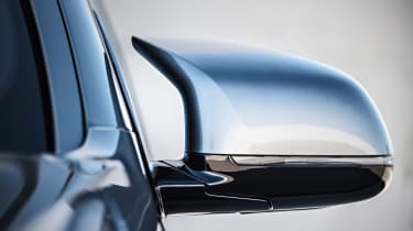 Unique door mirrors help reduce aerodynamic drag and give the X5 M a distinctive look