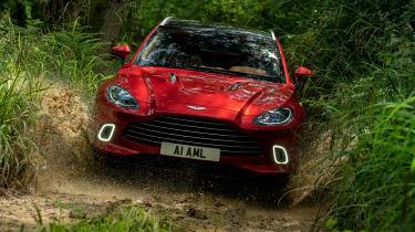 Aston Martin DBX SUV off-road water splash