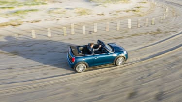 MINI Sidewalk Convertible driving on beach with roof down - top/side view