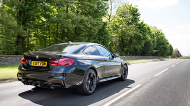 BMW M4 Coupe rear 3/4 driving