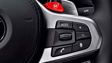 BMW M5 Competition - steering wheel controls close-up