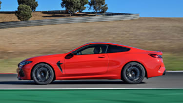BMW M8 Competition coupe side panning on track