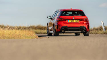 BMW M135i xDrive - dynamic rear 3/4