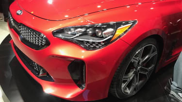 The Stinger is adorned with air vents and scoops, while the wide bumpers and low stance leave its potency in no doubt